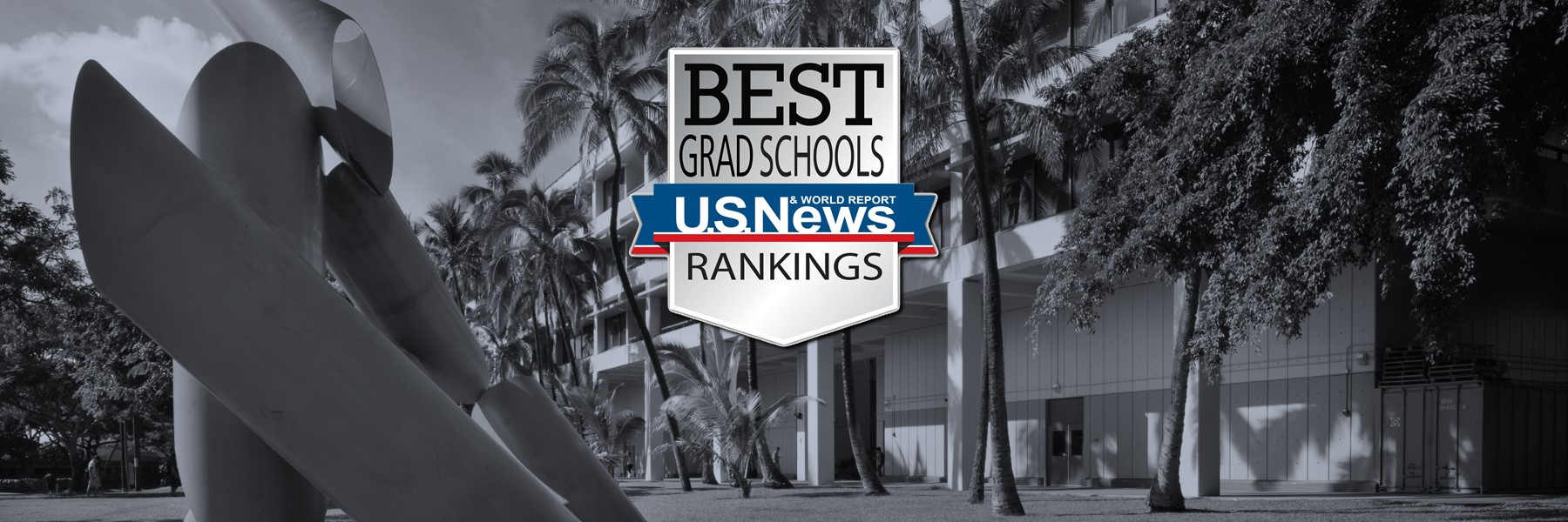 US News And World Report Rankings Badge Over An Unsaturated Photo Of Holmes Hall.