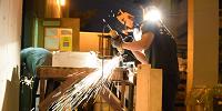 Student grinding metal