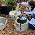 Engineering students handling wastewater samples.