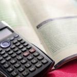 Calculator on top of a math book.
