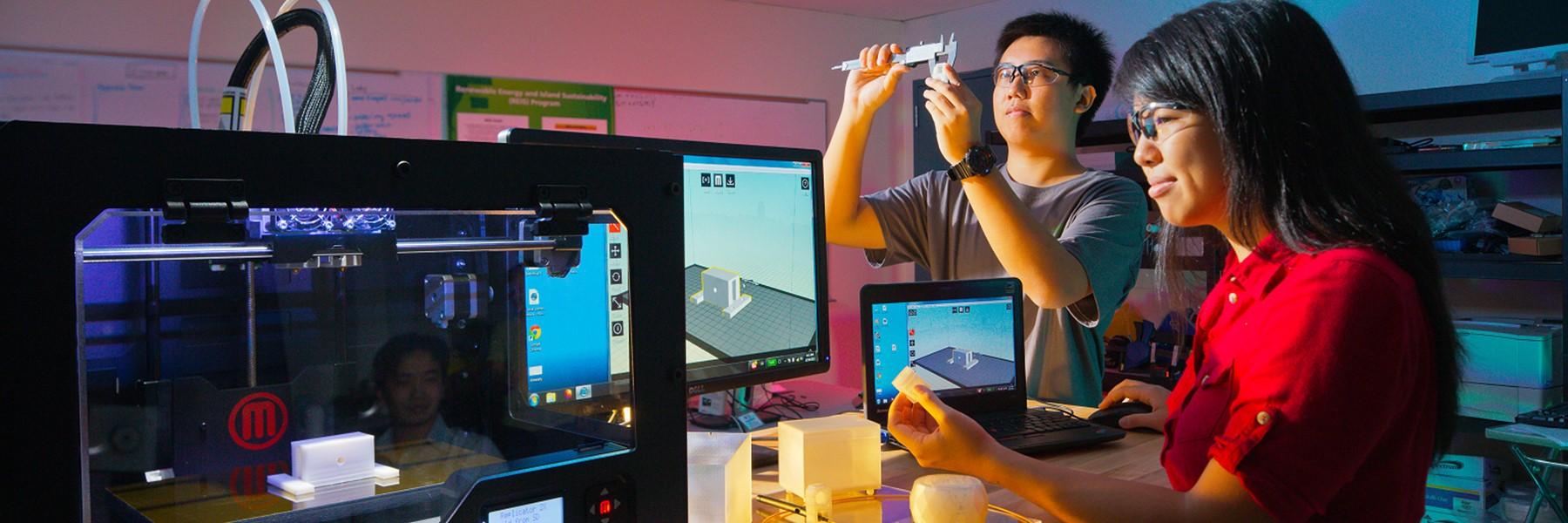Students Operating A 3D Printer.
