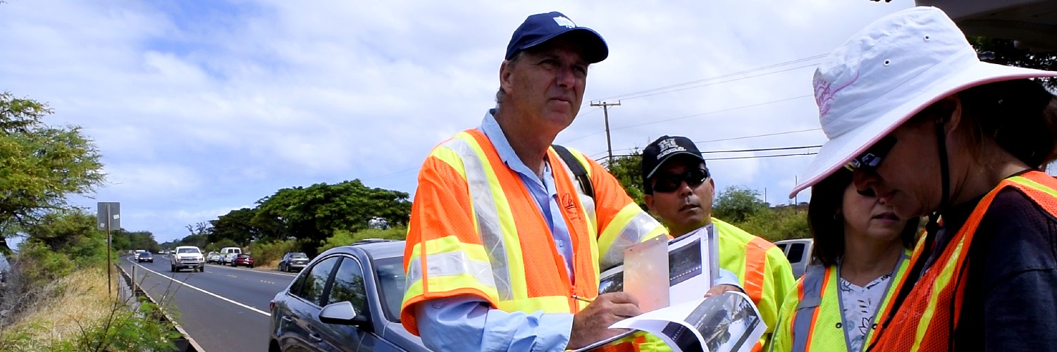 Prof. Brandes Surveying A Section Of Highway On Maui