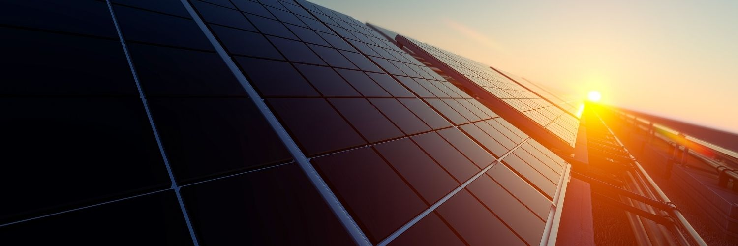 Photo Of Sun Setting Over Some Solar Panels