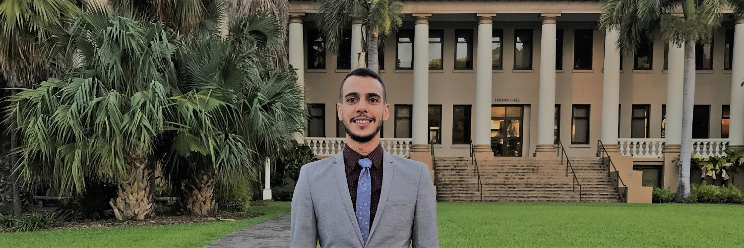 Student Standing In Front Of Hawaiʻi Hall