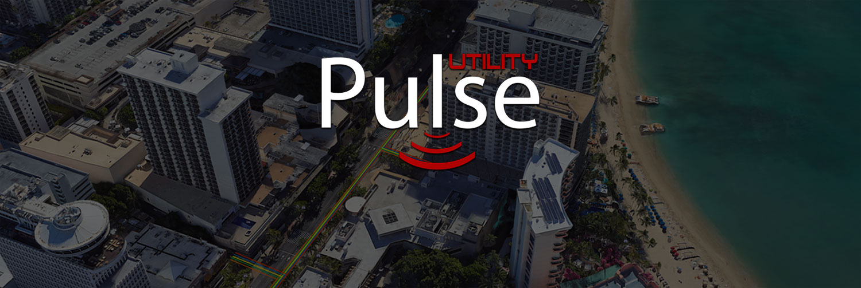 Utility Pulse Logo Over Darkened Aerial Image Of Waikiki