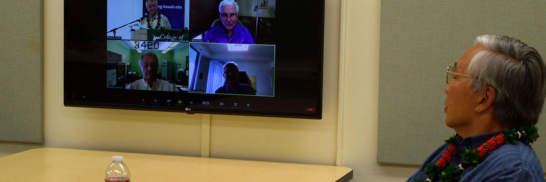 Professor Watching A Zoom Meeting