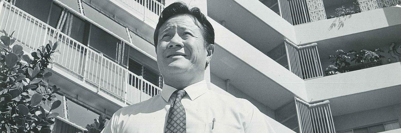 Al Yee Standing In Front Of Diamond Head Apartments